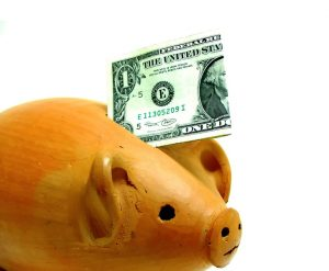 dollar and wooden piggy bank