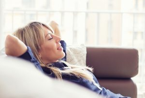 woman looking very comfortable in air conditioned home