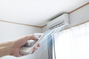 ductless-unit-and-remote-in-hand