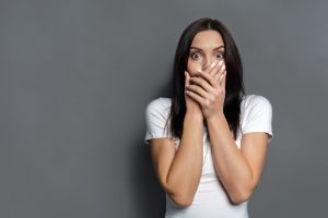 surprised-woman-covering-mouth