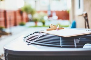 outdoor-ac-unit-with-clipboard-on-it