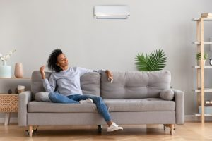 woman-enjoying-the-breeze-from-her-ductless-air-handler