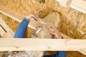 technician-hands-sealing-ductwork