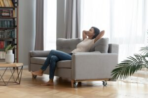 woman-sitting-on-couch-looking-comfortable