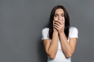 woman-covering-mouth-in-surprise